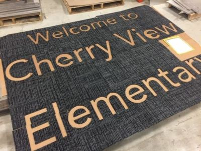 Waterjet Cutting Letters in Carpet